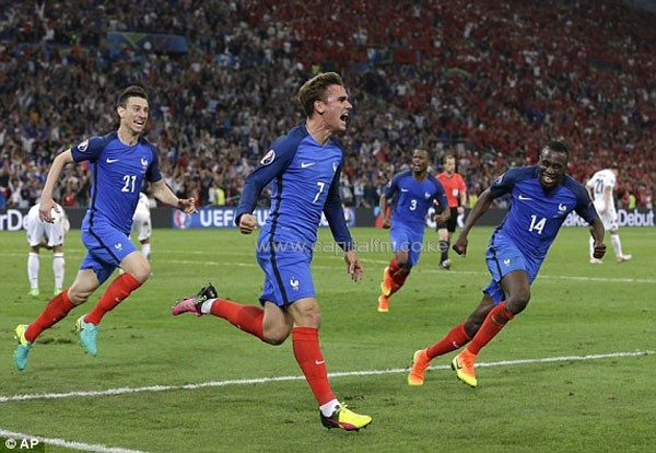 France's Antoine Griezmann (centre) celebrates after scoring. PHOTO/AP