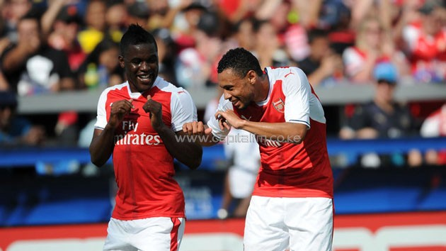 Joel Campbell and Francis Coquelin celebrate.