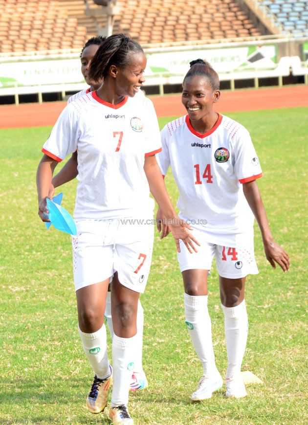 Cherish Avilia (legft) and Esse Akida share a light moment during training.