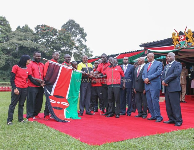 President Uhuru Kenyatta handing over the flag to Team Kenya. He released a tough statement last week saying action must be taken on those found guilty of mismanaging the team in Rio
