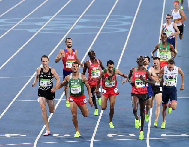 Asbel Kiprop easing off at the finish line to win his semi-final. PHOTO/IAAF