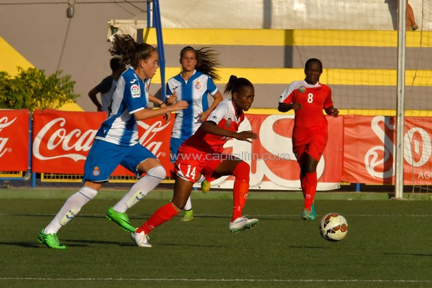 Harambee Starlets forward Esse Akida wheels past an Espanyol opponent during their group match. PHOTO/COTIF