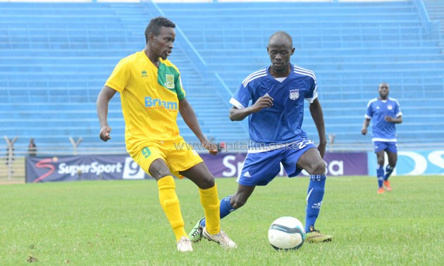 Mathare United's Harrison Mwenda takes on Ezekiel Odera.PHOTO/Timothy Olobulu