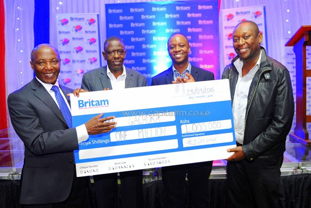 Britam Holdings Group Managing Director Dr. Benson Wairegi (left) presents a cheque worth Sh1mn  to Kanyi Gachoka, the winner of the Britam@50 Corporate Golf tournament held at Muthaiga Golf Club over the weekend.  Looking on are  Britam's Director for Marketing and Corporate Affairs, Mr Muthoga Ngera and  Britam Asset Managers CEO Kenneth Kaniu.
