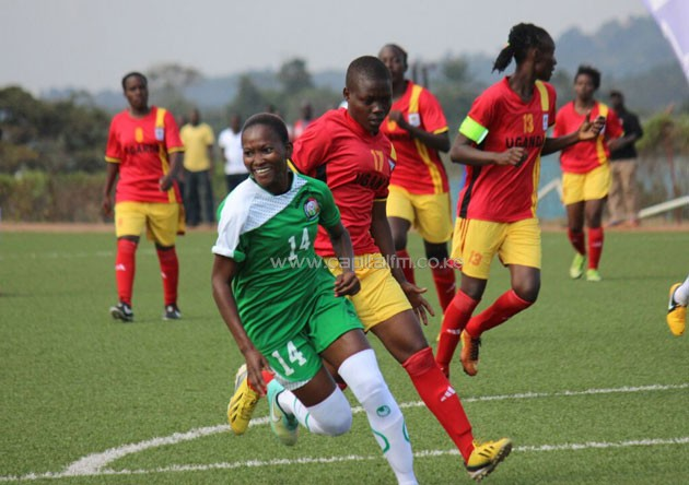 Harambee Starlets forward Esse Akida wheels away in celebration after scoring against Uganda. PHOTO/COURTESY