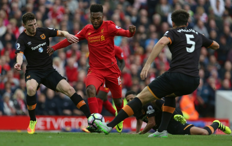 Liverpool's Daniel Sturridge (C) vies with Hull's Andrew Robertson (L) and Harry Maguire during their English Premier League football match in Liverpool, north west England on September 24, 2016