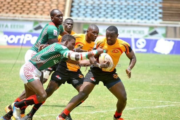 Kenya Morans' Lameck Dunde attempts to stop Uganda's Erick kasita in an Africa Sevens Cup match at the Moi Sports Centre Kasarani on September 24, 2016. PHOTO/RAYMOND MAKHAYA