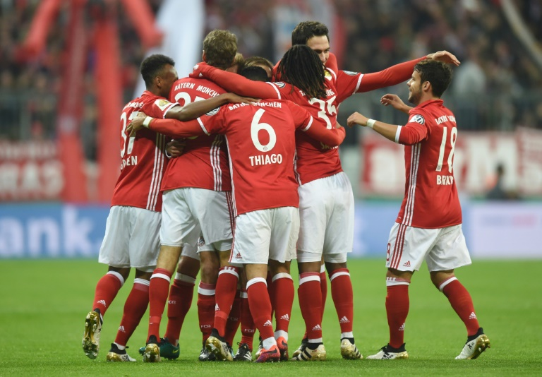 Bayern Munich players celebrate after Philipp Lahm scores the opening goal against Augsburg in Munich, southern Germany on October 26, 2016