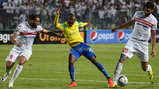 Zamalek's defenders Ahmed Mohamed Abdalla El-Sayed Nouh (L) and Ali Mossad defend against Sundown's Zimbabwean forward Khama Billiat. PHOTO/Guardian
