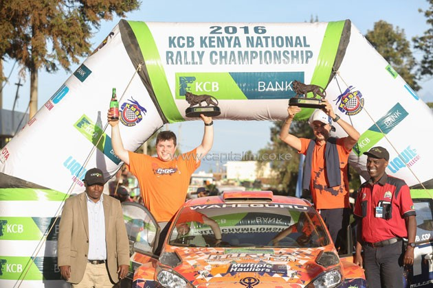 Drew Sturrock of Britain (left) and his driver Manvir Baryan celebrate their career best second rally in Eldoret.PHOTO/courtesy
