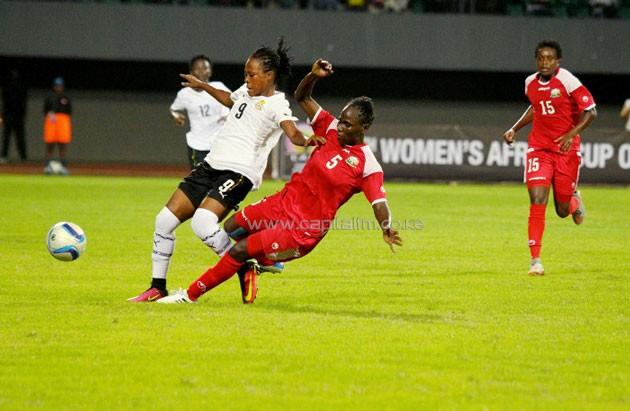 Kenya's Dorcas Shikobe tackles Ghanaian forward Samira Suleiman. PHOTO/CAF