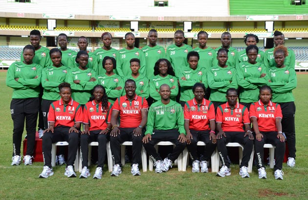 Harambee Starlets players and technical bench members pose for a group photo with FKF President Nick Mwendwa. PHOTO/Timothy Olobulu