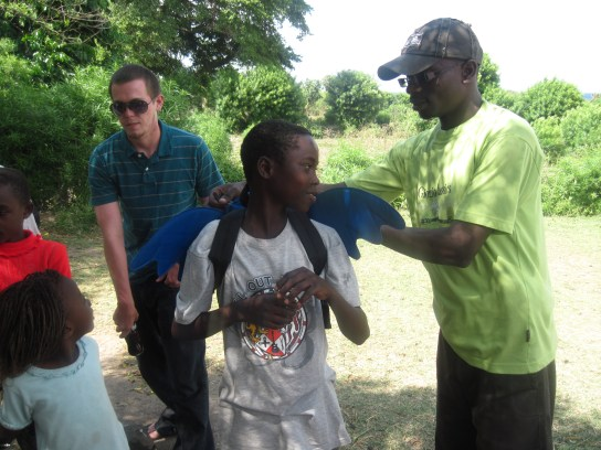 James Orwa giving gifts to students