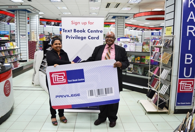 Prof. Bethwell Ogot poses for a photo with Lily-Anne Fernandes the first customer to receive the TBC privilege card.