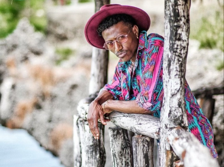 Octopizzo-rocking-a-Fedora-hat-with-a-colorful-shirt